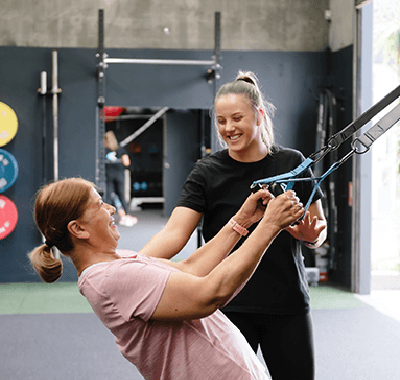 Woman and exercise trainer doing arm workout