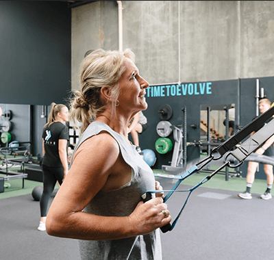 Woman doing arm and back workout
